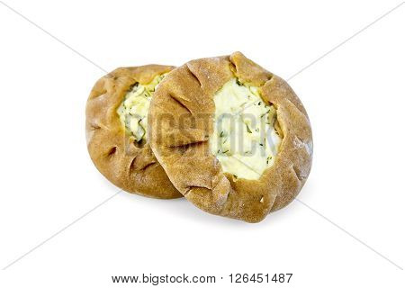 Two round patty carols from rye flour with a stuffing of cheese isolated on white background