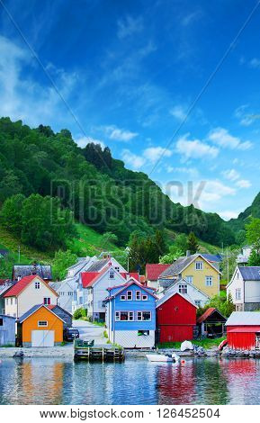 a view of colored village in Norwegian fjord