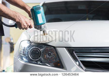 Car detailing series : Worker polishing white car