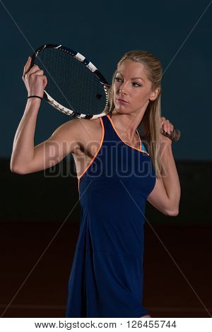 Woman Keeps Tennis Racket And Ball On Shoulders
