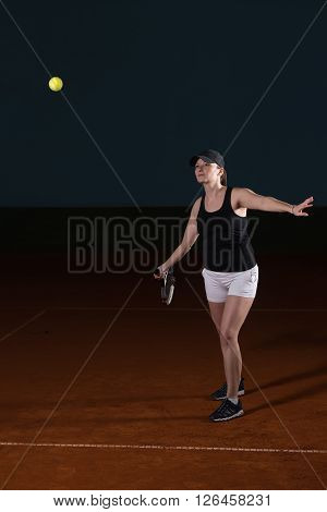 Tennis Player Hitting Tennis Ball