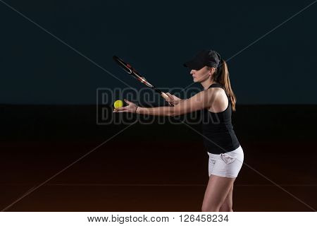 Young Woman Ready To Serves Toss Ball