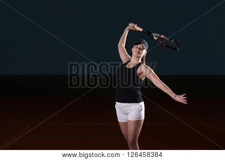 Woman In Sportswear Serves Tennis Ball
