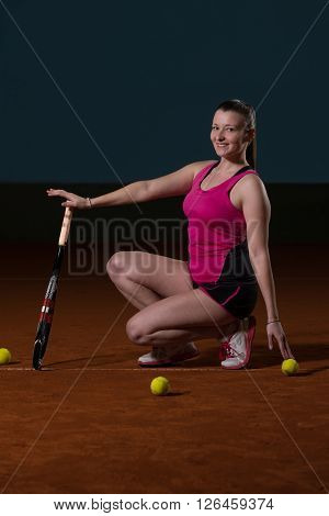 Female Tennis Player With A Racket Indoors
