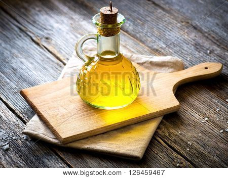 Extra virgin Olive oil on vintage wooden table