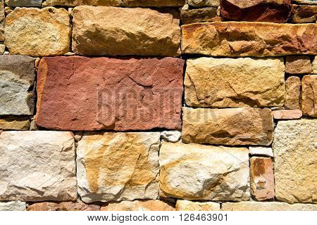 The big stones wall yellow color bakground