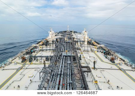 Deck of oil tanker in the blue sea while calm weather.