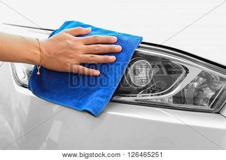 Hand woman with microfiber cloth cleaning car