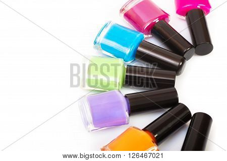 Several colored nail polish on a white background