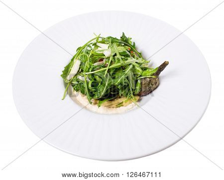 Summer baked eggplant salad with fresh vegetables and tahini sauce. Isolated on a white background.