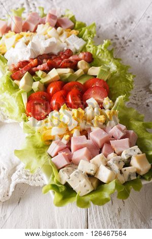 Tasty American Cobb Salad Close-up On A Plate. Vertical