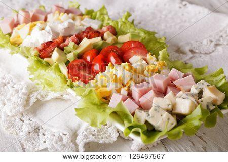 Tasty Cobb Salad Close-up On The Table. Horizontal