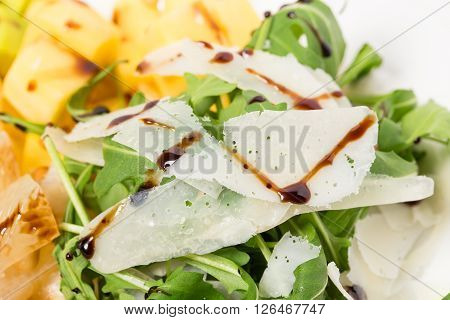 Jumbo shrimp salad with arugula and mango topped with pine nuts and parmesan cheese. Macro. Photo can be used as a whole background.