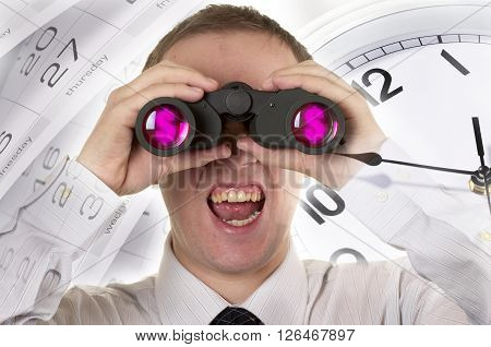 Man with binoculars observing over clocks fragment and calendar macro shot
