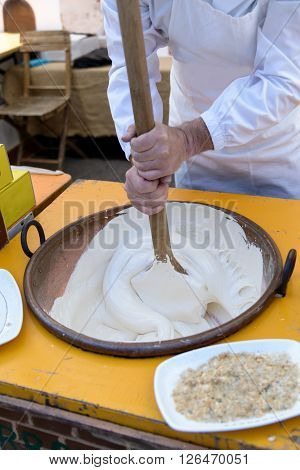 Artisan preparation of nougat in Sardinia typical cake.