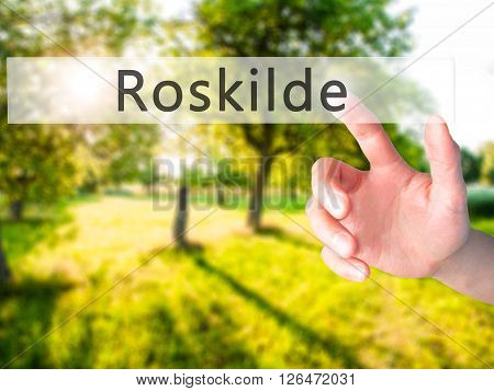 Roskilde - Hand Pressing A Button On Blurred Background Concept On Visual Screen.