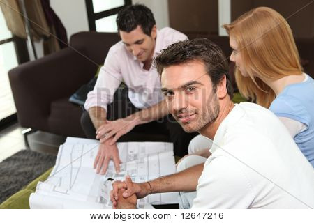 Portrait of a man with a woman and a realtor