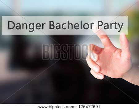Danger Bachelor Party - Hand Pressing A Button On Blurred Background Concept On Visual Screen.