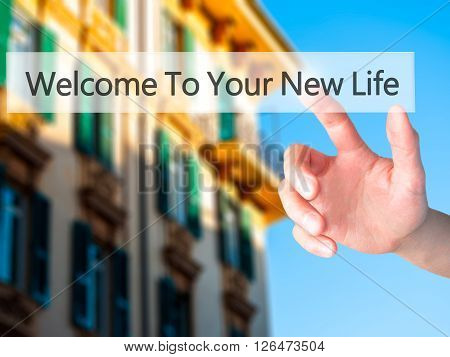 Welcome To Your New Life - Hand Pressing A Button On Blurred Background Concept On Visual Screen.