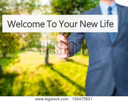 Welcome To Your New Life - Businessman Hand Holding Sign