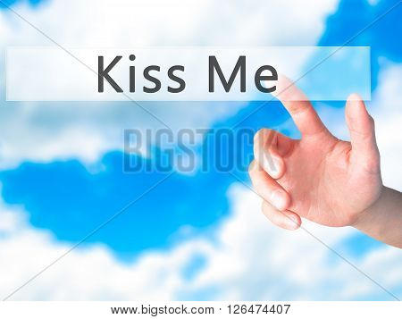 Kiss Me - Hand Pressing A Button On Blurred Background Concept On Visual Screen.