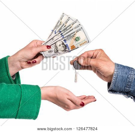 Selling property concept. Real estate agent giving house keys to a new property owner woman giving dollar bills on a white background
