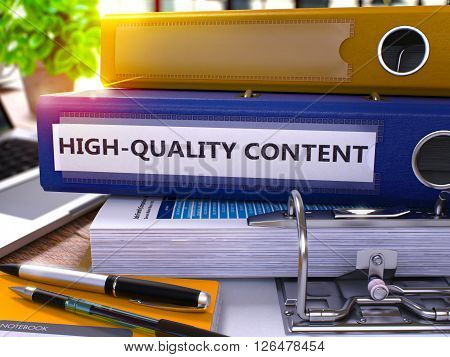 High-Quality Content - Blue Office Folder on Background of Working Table with Stationery and Laptop. High-Quality Content Business Concept on Blurred Background. High-Quality Content Toned Image. 3D.