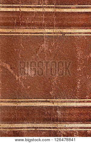 Old damaged brown leather book spine texture with spots and craquelures