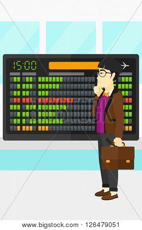 Man looking at schedule board.