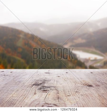 Wooden table on blurred nature background