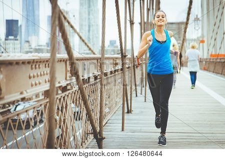 Running on the brooklyn bridge. sport and fitness