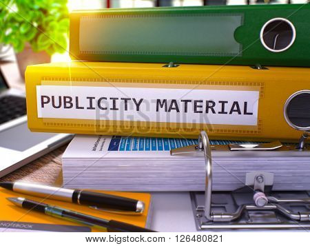 Publicity Material - Yellow Ring Binder on Office Desktop with Office Supplies and Modern Laptop. Publicity Material Business Concept on Blurred Background. 3D Render.