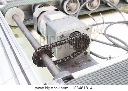 Motor drive shaft and transmission chain conveyor.
