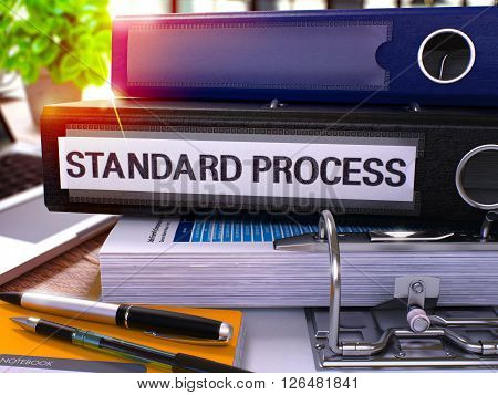 Standard Process - Black Office Folder on Background of Working Table with Stationery and Laptop. Standard Process Business Concept on Blurred Background. Standard Process Toned Image. 3D.