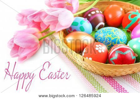 Easter greeting card. Multicoloured eggs and tulips on napkin, closeup