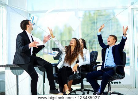 business people excited happy smile, throw papers, documents fly in air