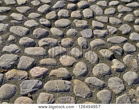 Old cobbled stone street, close up texture.
