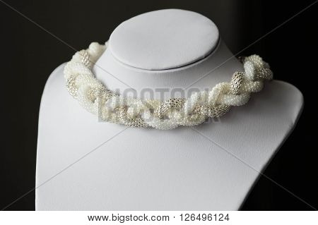 Handmade Necklace Of White Beads In The Form Of Braid