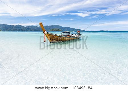 Long-tail Boat Floating On Crystal Clear Sea Water At Tropical Island, Andaman Sea