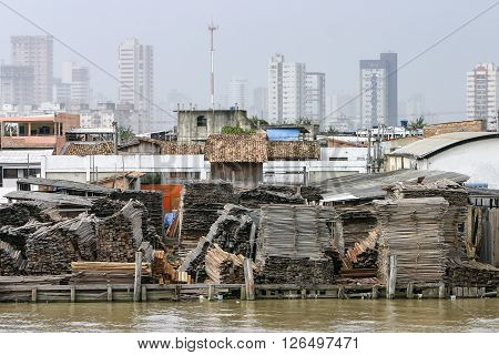 Belem: Timber axes of the Amazon forest stacked for sale or export in a lumberyard on the Guama River