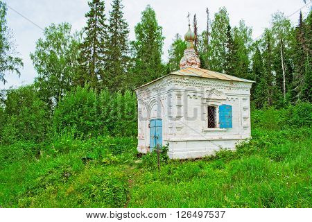Little old Orthodox chapel in the woods. Russia