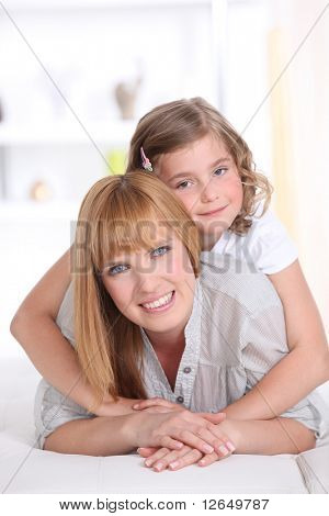 Girl laid on the back of a smiling woman