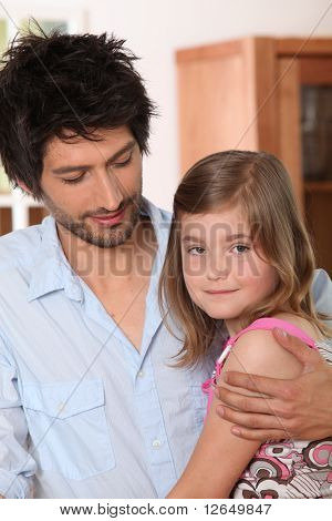 Portrait of a little girl in the arms of a man