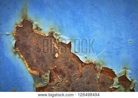 Macro view of old rusting steel and color blue