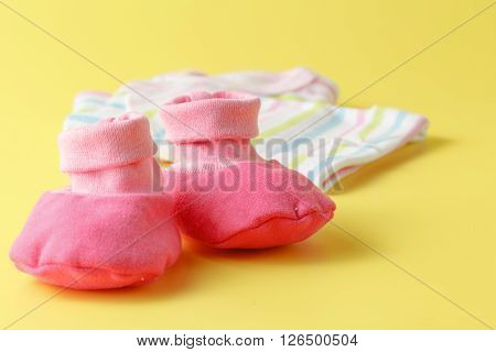 Baby Clothing On A Plain Bright Background