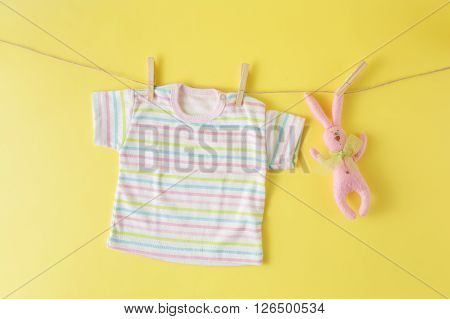 Baby Clothes And Easter Rabbit On A Clothesline