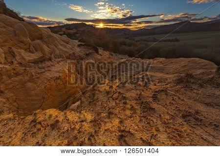 Sunrise at an old and abandoned gypsum quarry