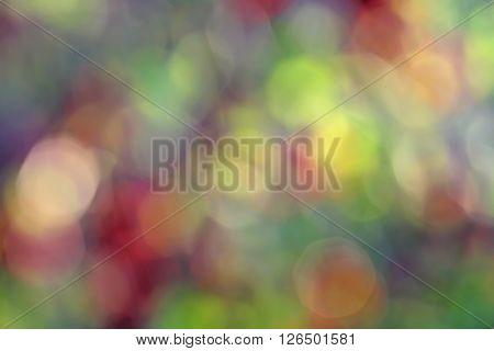Bokeh effect in the background illustration to create a background for a picture. Bright red colored spots in the green range.