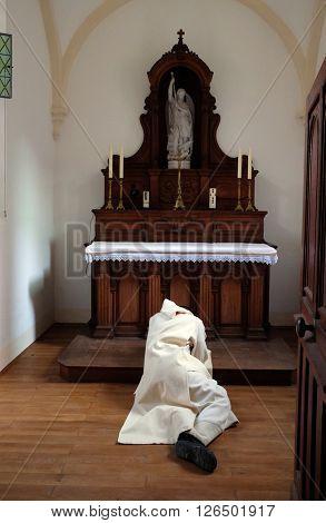 PLETERJE, SLOVENIA - NOVEMBER 06: Carthusians Monks praying in chapel in the Carthusian monastery in Pleterje, Slovenia on November 06, 2015.
