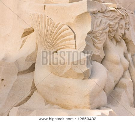 sand sculpture festival contest:   	 sand sculpture of mermaid